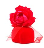 Red rose and gift. Decor on a red rose and gift Stock Image