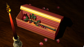 Red Rose in Gift Box with Candle and Flower Petals. On a wooden table Stock Photos