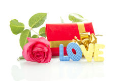 Red Rose, gift box and the text LOVE Royalty Free Stock Photo