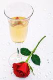 Red rose and a glass of champagne Royalty Free Stock Photos