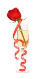 Red rose in glass of champagne and paper streamer. Royalty Free Stock Images