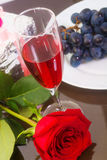 Red rose, glass wine and winegrape Royalty Free Stock Photo
