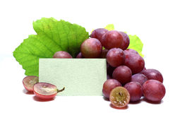 Red rose grapes with blank papers card Stock Photo