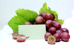 Red rose grapes with blank papers card Stock Photography