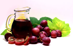 Red rose grapes and glass jug bottle royalty free stock photography
