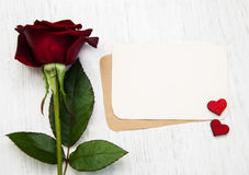 Red rose and greeting card Royalty Free Stock Photo