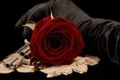 Red rose with handgun Royalty Free Stock Photo