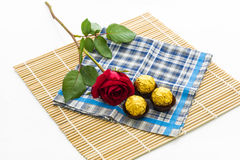 Red rose with handkerchief  and chocolate Ball, placemat Royalty Free Stock Image