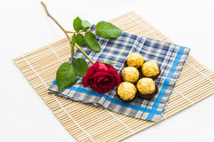 Red rose with handkerchief  and chocolate Ball, placemat Stock Image