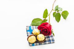 Red rose with handkerchief  and chocolate Ball Royalty Free Stock Image