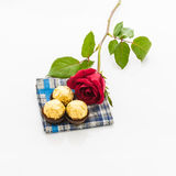 Red rose with handkerchief  and chocolate Ball Royalty Free Stock Images