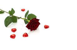 Red rose and heart shape chocolate Royalty Free Stock Images