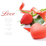 Red rose and heart-shaped decoration Stock Images