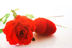 Red rose with heart-shaped red velvet Royalty Free Stock Images
