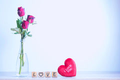 Red rose with heart and wooden alphabet Stock Photos