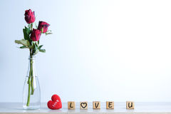 Red rose with heart and wooden alphabet Stock Images