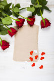 Red rose, hearts and paper for congratulations Stock Image