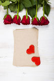 Red rose, hearts and paper for congratulations Royalty Free Stock Photo