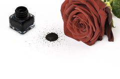 Red rose and ink pot on paper. Red rose, ink pot and drop on white paper Royalty Free Stock Image