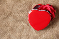 Red rose in iron box shape heart form Royalty Free Stock Images