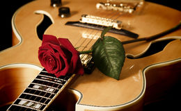 Red rose and jazz guitar Royalty Free Stock Images