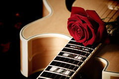 Red rose and jazz guitar Stock Image