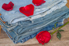 Red rose and jeans Royalty Free Stock Photography