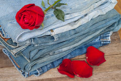 Red rose and jeans Royalty Free Stock Photo