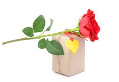 A red rose and parcel Stock Images