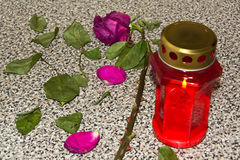 Red rose and lantern on the tombstone Stock Images