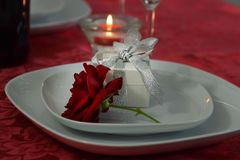 A red rose with a white box with a silver ribbon Stock Images