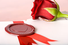 Red rose and love-letter with seal Royalty Free Stock Image