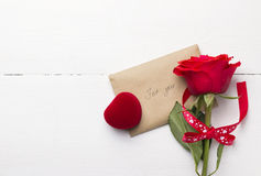 Red rose, love message, casket with a ring Royalty Free Stock Photography