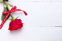 Red rose of love on a white wooden background. Red rose of love on a white wooden background Royalty Free Stock Images