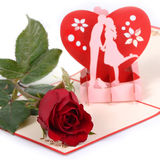 Red rose on lovely card. Stock Image