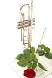 Red rose and old notes Sheet music trumpet Royalty Free Stock Image