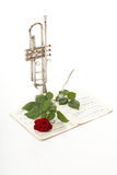 Red rose and old notes Sheet music trumpet Royalty Free Stock Photos