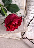 Red Rose on Old Paper Stock Photo