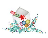 Red Rose in Open Envelope with Christmas Balls. A Lovely Red Rose in White Envelope and Christmas Ball or Christmas Ornament, Sign for Start Christmas Royalty Free Stock Photography