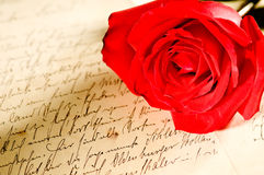 Red rose over a hand written letter Royalty Free Stock Images