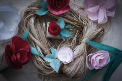 Red and rose paper flowers. Gift, Red, rose paper flowers on the wooden background and bast. Cut from paper. Place for your text Stock Image