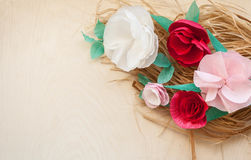 Red and rose paper flowers. On the wooden background and bast. Cut from paper. Place for your text Stock Photo