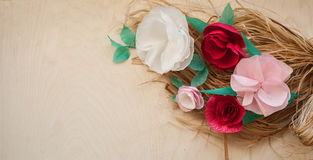 Red and rose paper flowers. On the wooden background and bast. Cut from paper. Place for your text Royalty Free Stock Photos