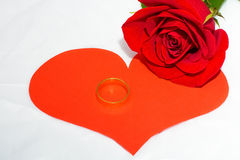 Red rose and paper heart, ring of gold Stock Photos