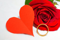Red rose and paper heart, ring of gold Royalty Free Stock Photo