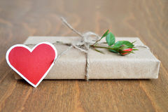 Red rose and parcel  wrapped in brown paper Royalty Free Stock Photo