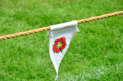 Red rose on pennant Stock Photography
