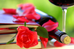 Red rose petals on books. Royalty Free Stock Photo