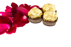 Red rose petals  with Chocolate ball on white Royalty Free Stock Photo