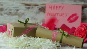 Red rose petals falling down on wooden table. 4k dolly shot.  stock footage